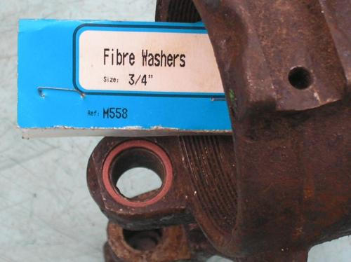 13) Fibre washer used as a seal