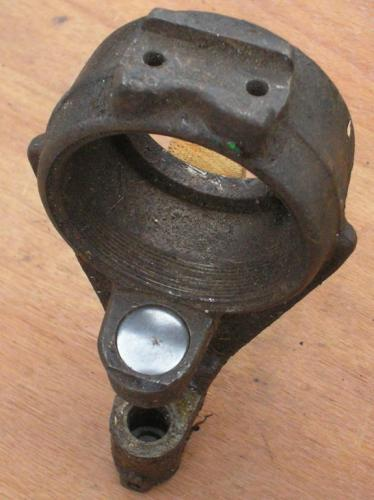 14) Welch plug fitted into housing